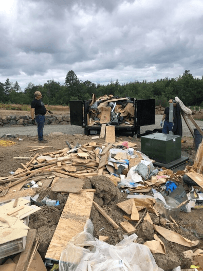 A picture of a trailer full of construction junk left over from building site. This picture was taken in Gresham Oregon.